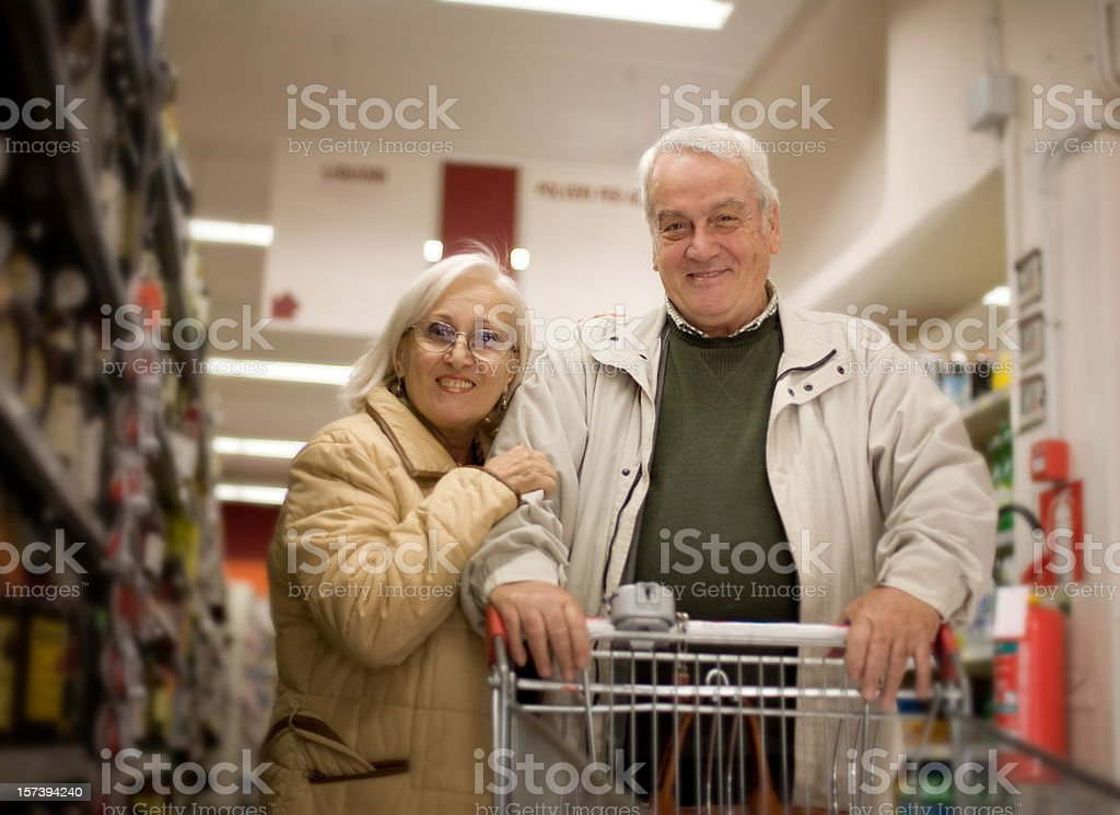 Happy senior couple shopping in a mall royalty-free stock photo