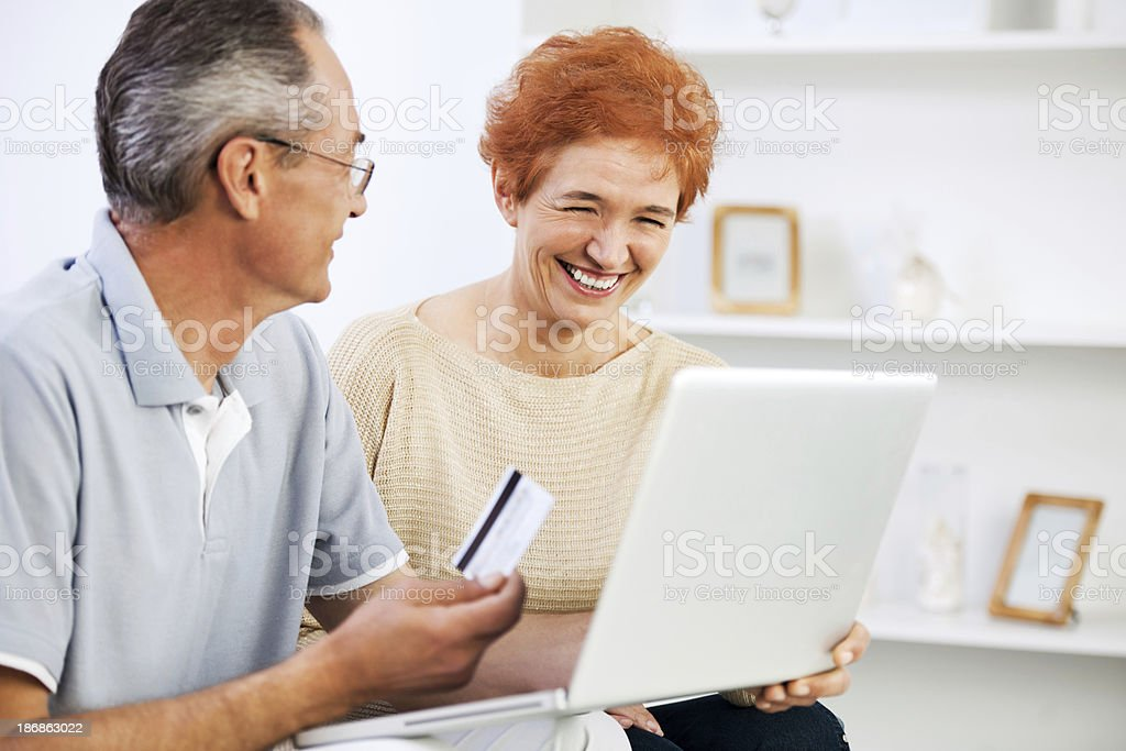 Happy senior couple shopping online. royalty-free stock photo