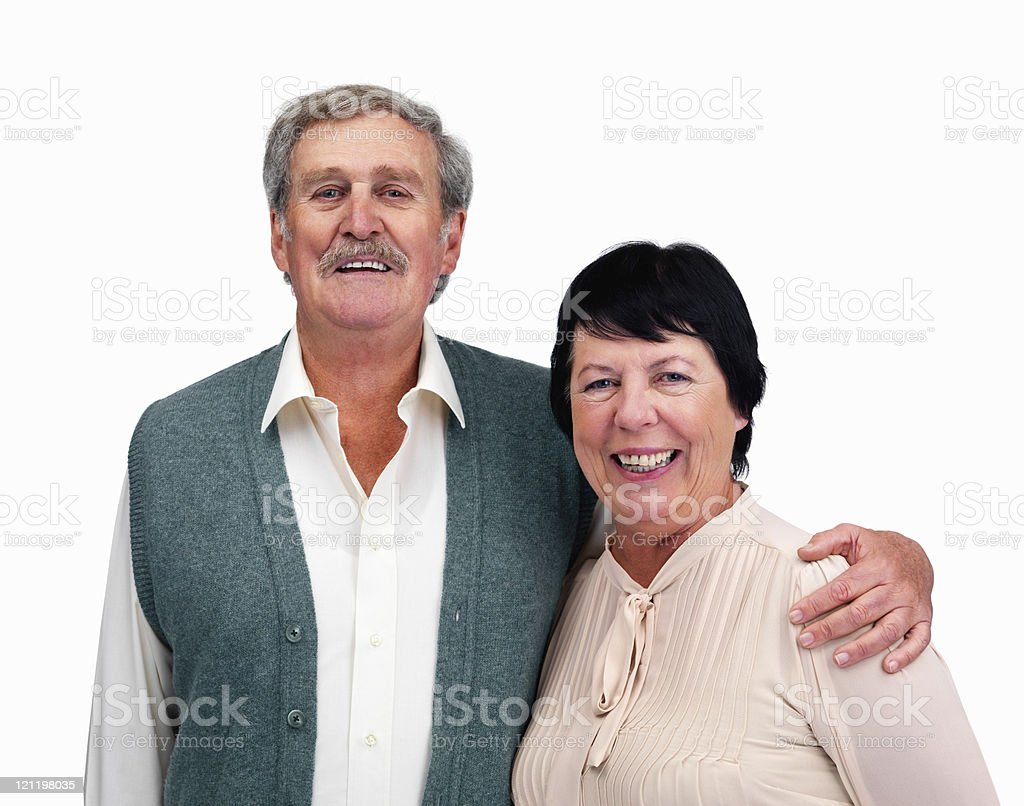 Happy senior couple standing together against white royalty-free stock photo
