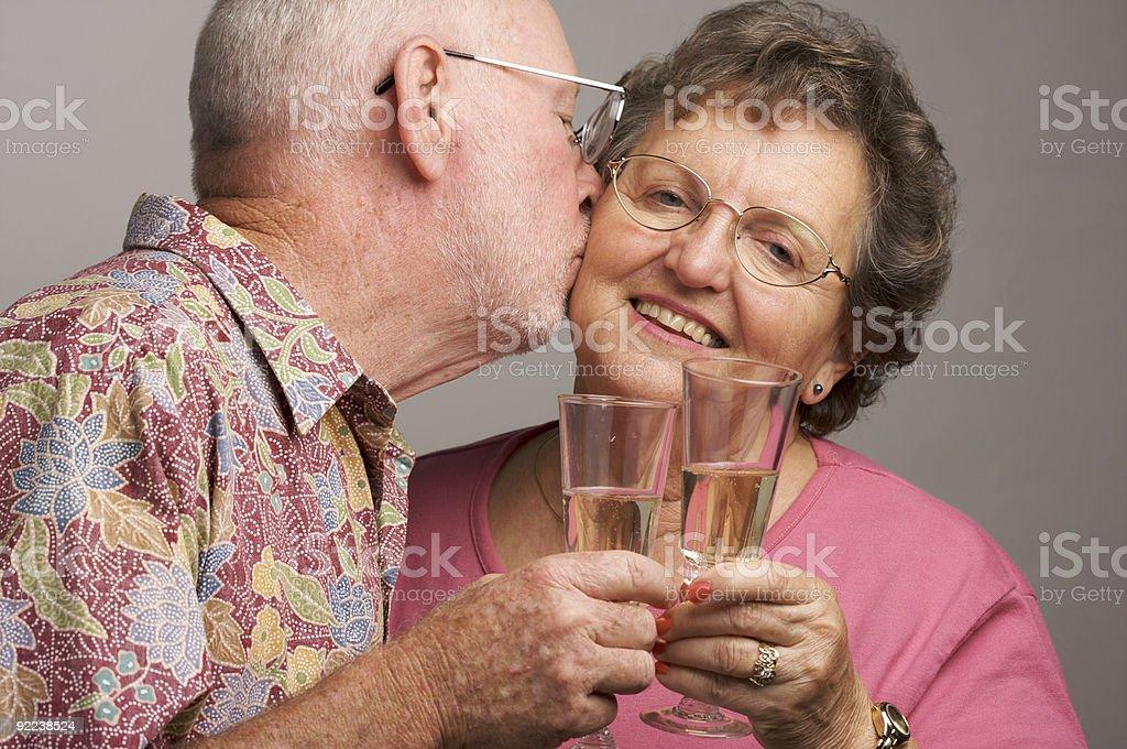 Happy Senior Couple Toasting Champagne royalty-free stock photo