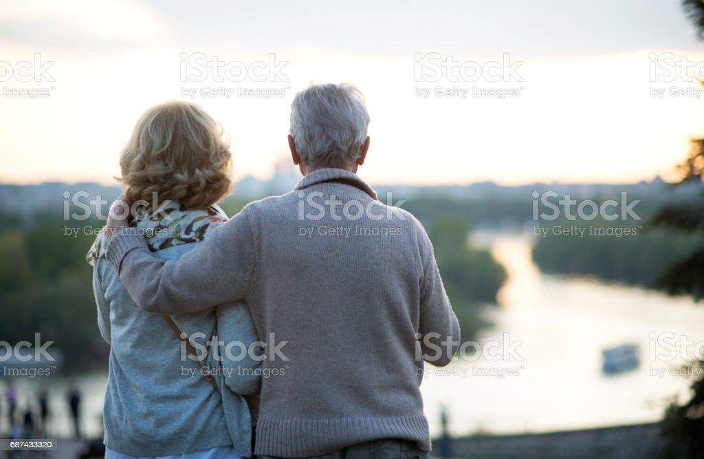 Happy senior couple traveling stock photo