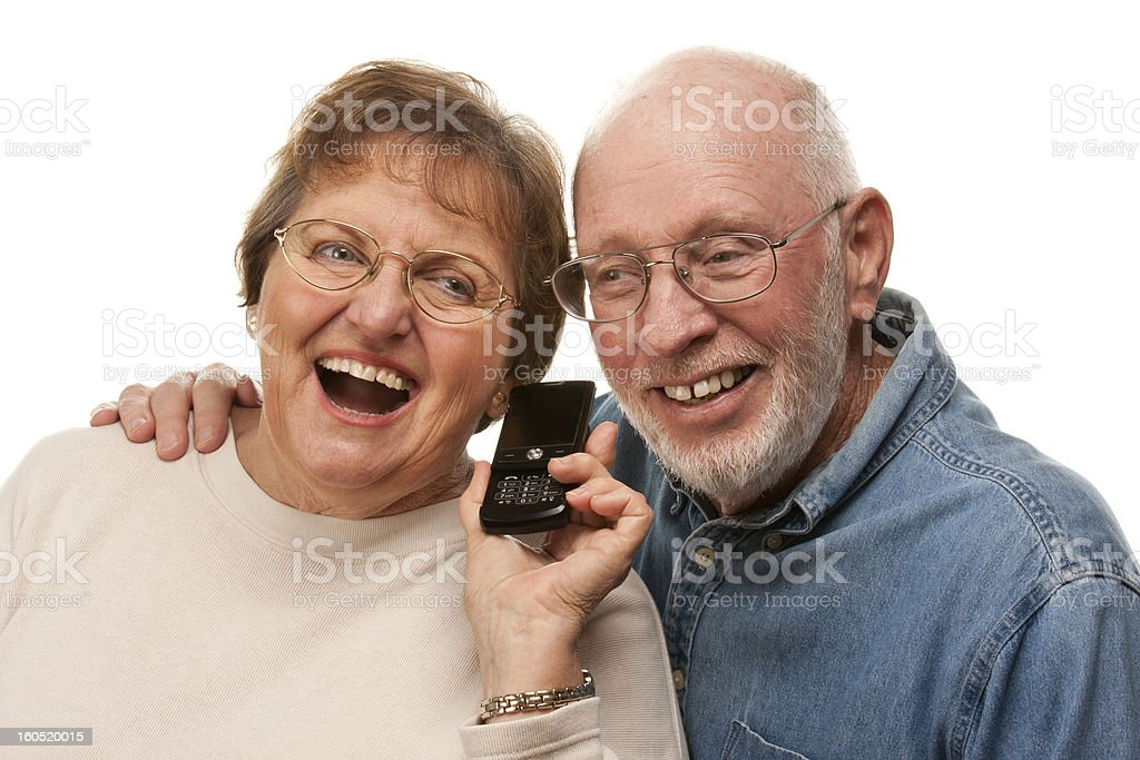 Happy Senior Couple Using Cell Phone on White royalty-free stock photo