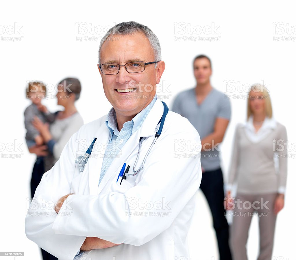 Happy senior doctor with family standing in background Happy senior doctor with family standing in background 60-64 Years Stock Photo