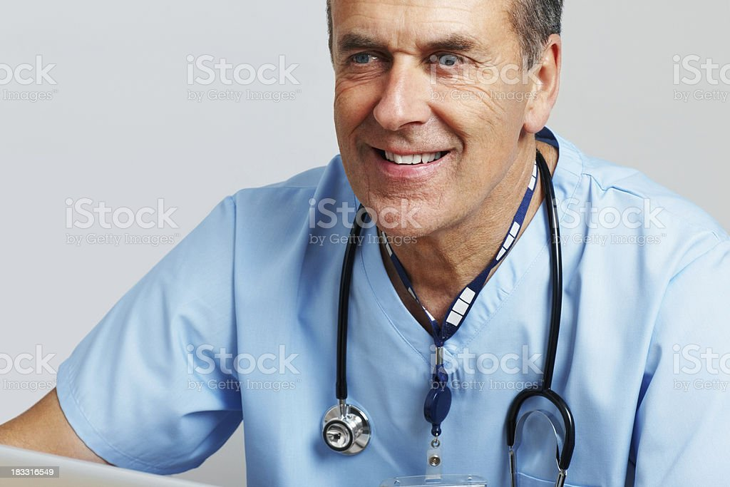 Happy senior doctor with stethoscope against white background royalty-free stock photo