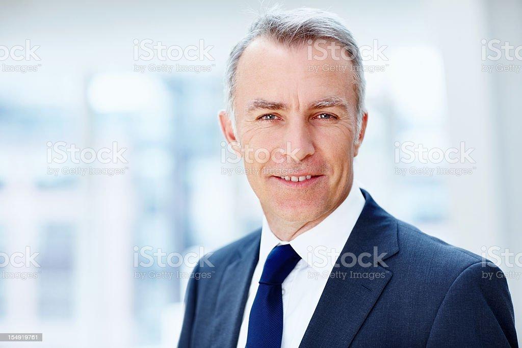 Happy senior executive indoors royalty-free stock photo