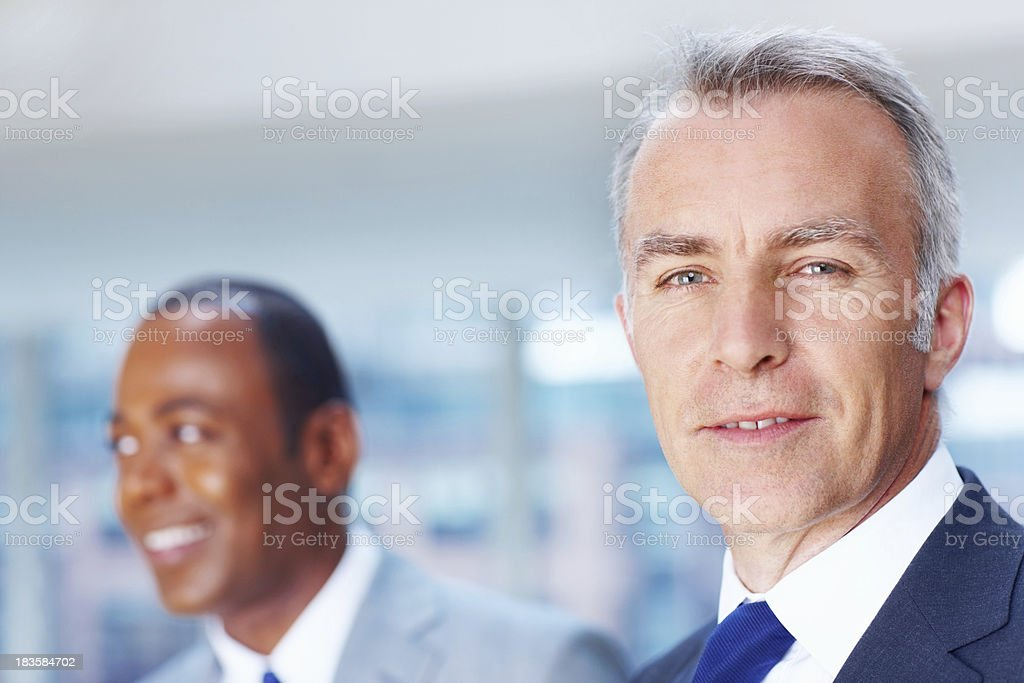 Happy senior executive with partner in background royalty-free stock photo