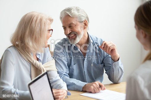 istock Happy senior family talking smiling at meeting with financial advisor 924512830