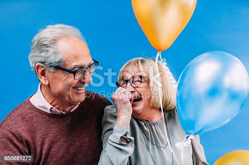 529076288 istock photo Happy Senior French Couple with Baloons 655681272