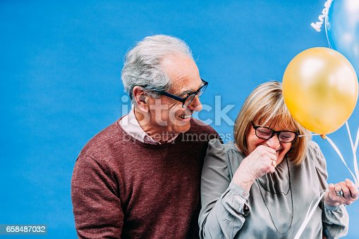 529076288 istock photo Happy Senior French Couple with Baloons 658487032