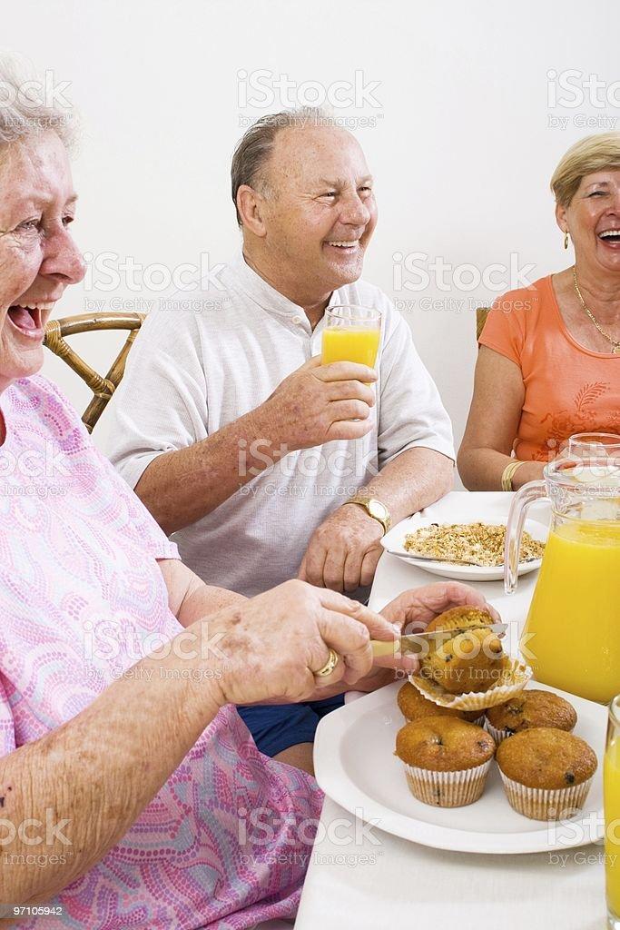 happy senior friends breakfast royalty-free stock photo
