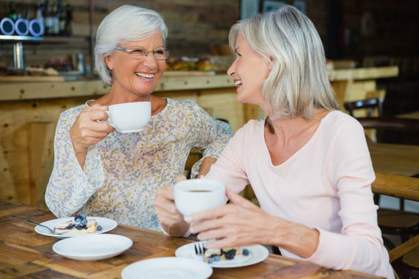 happy senior friends having coffee and breakfast - 60 69 years stock photos and pictures