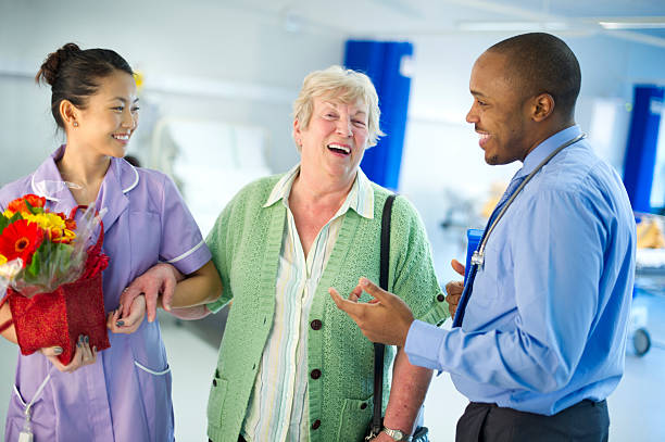 happy senior healthcare - outpatient stock pictures, royalty-free photos & images