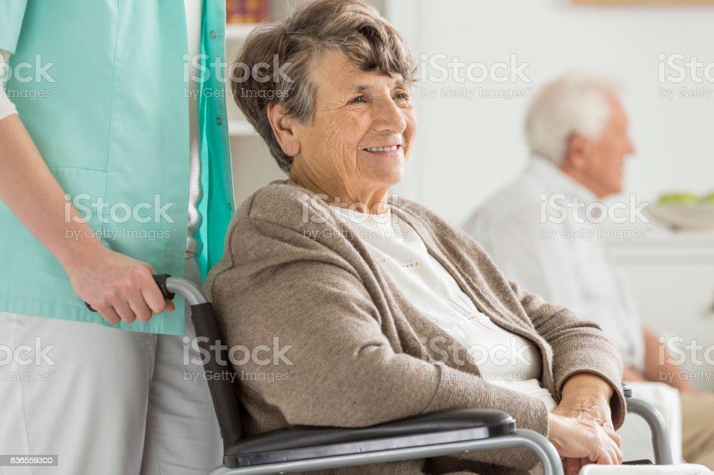 Happy senior in wheelchair stock photo