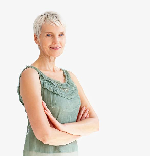 happy senior lady with her arms crossed - vrouw 60 stockfoto's en -beelden