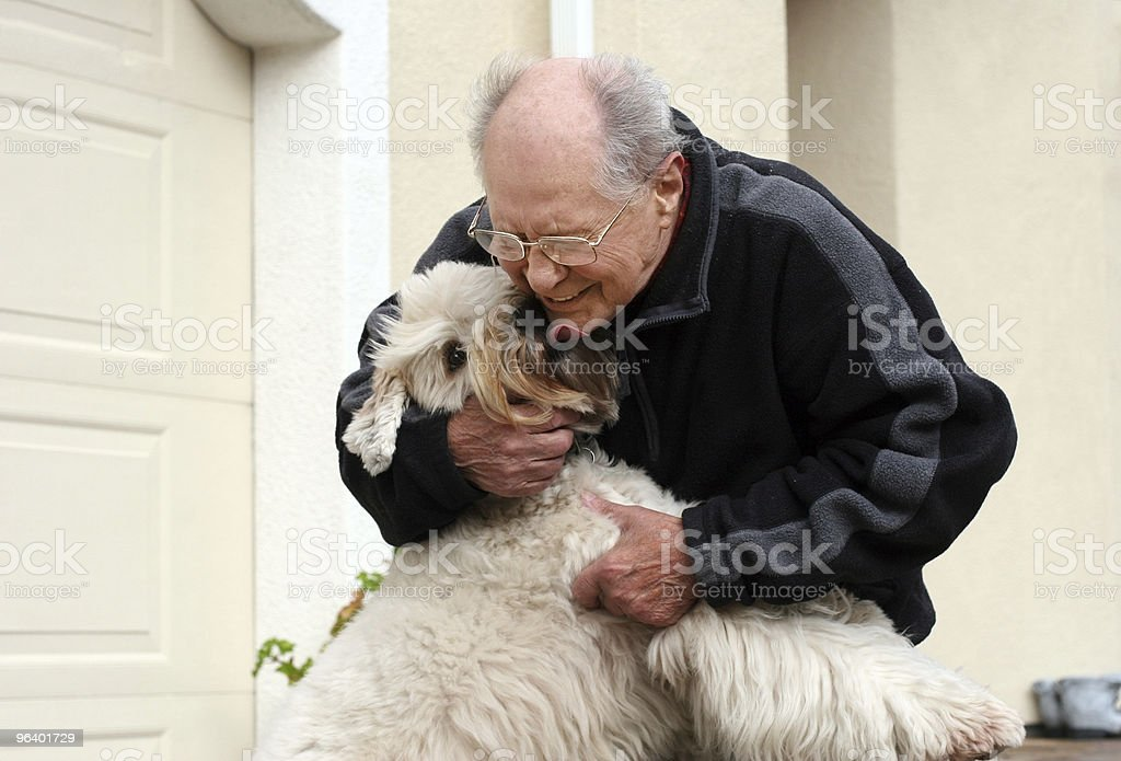 Happy senior man and his dog royalty-free stock photo