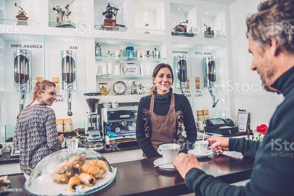 Happy Senior Man and Two Female Barista, Caffe Trieste, Europe stock photo