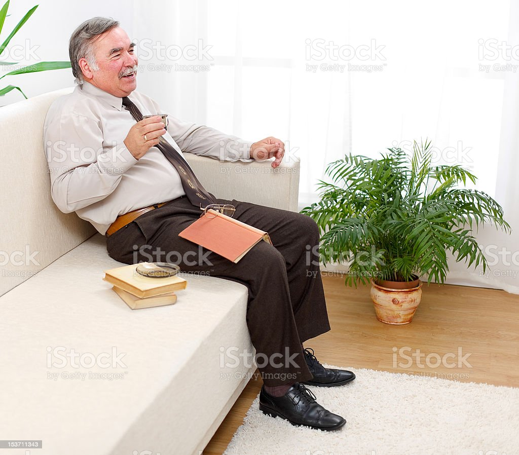 Happy senior man drinking coffee royalty-free stock photo