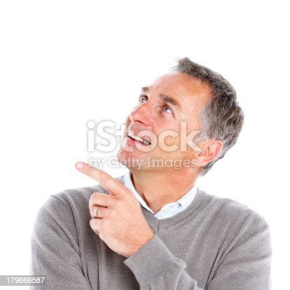 istock Happy senior man pointing at copyspace 179666587
