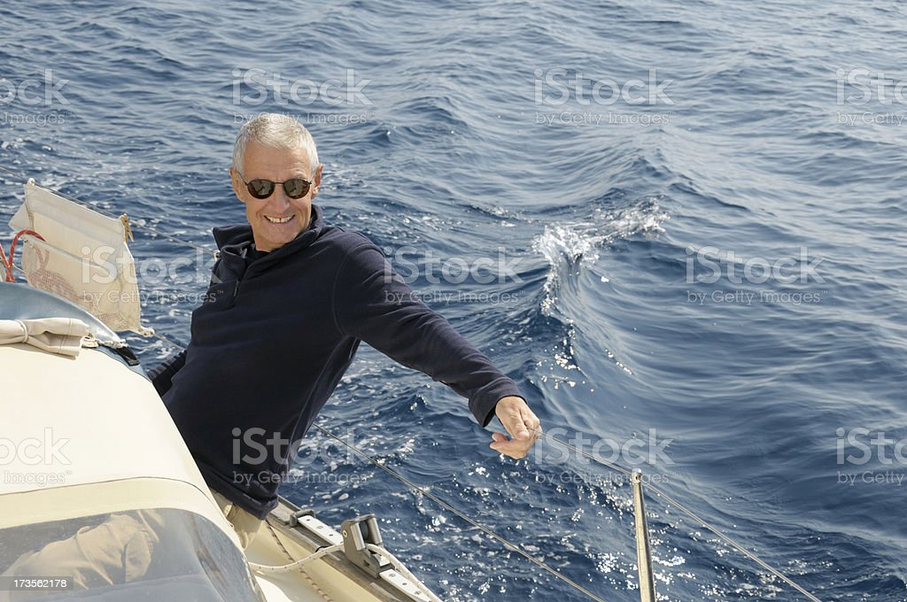 Happy senior man sailing royalty-free stock photo