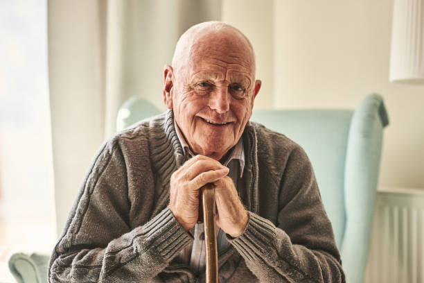 happy senior man sitting at home - idosos imagens e fotografias de stock