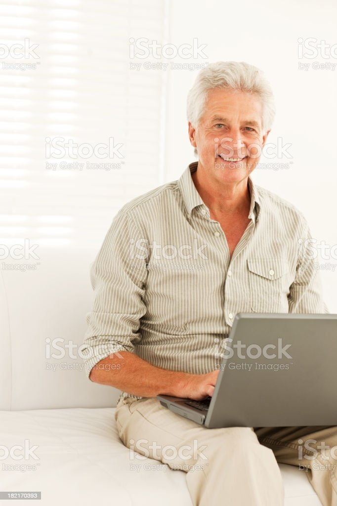 Happy senior man using laptop royalty-free stock photo
