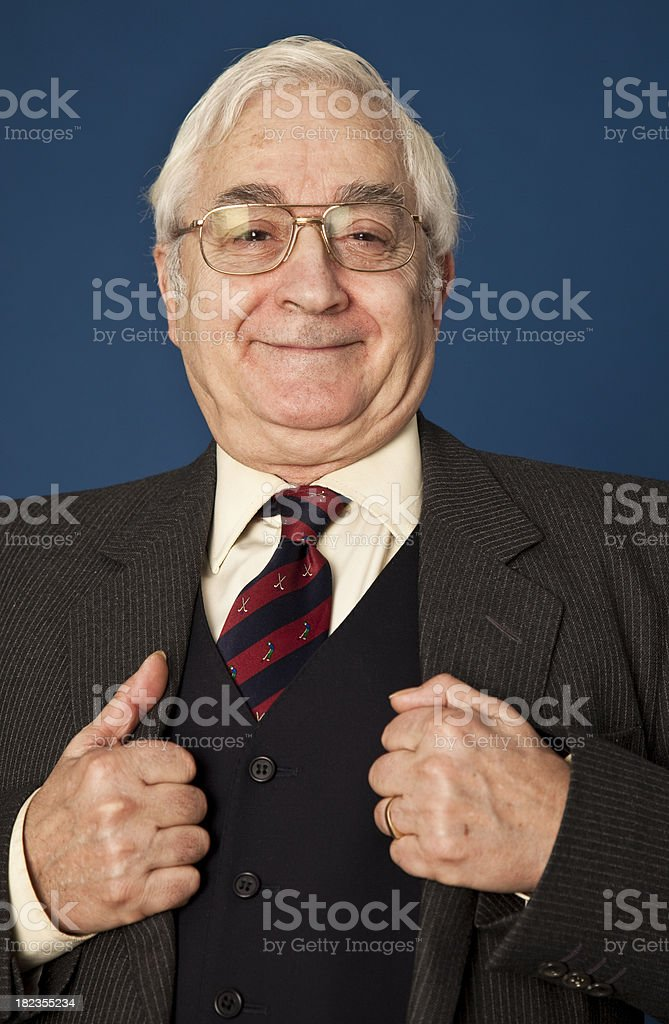 Happy senior man wearing a suit royalty-free stock photo