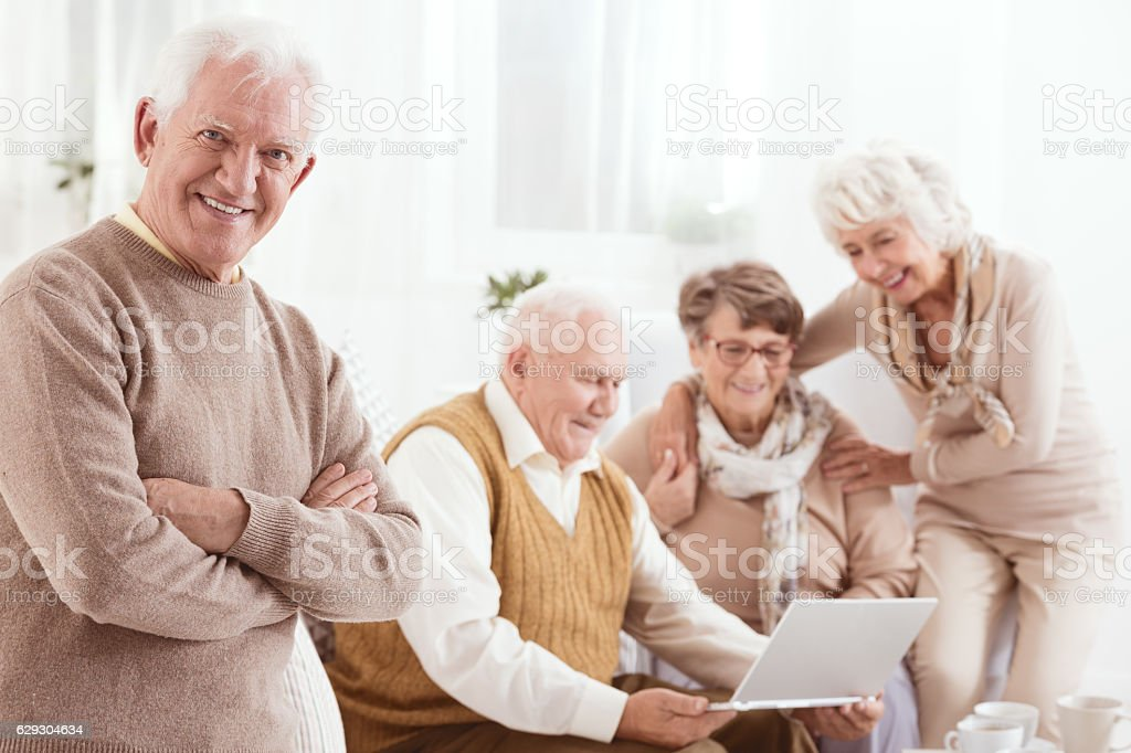Happy senior man with friends stock photo