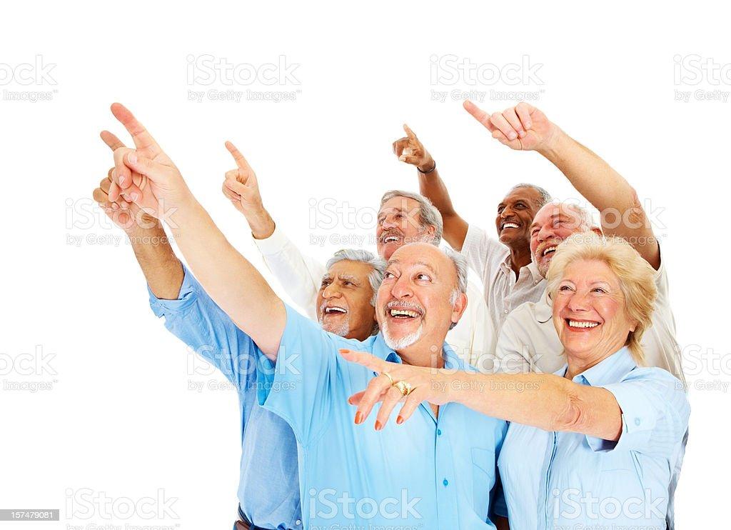 Happy senior men and women pointing upwards royalty-free stock photo