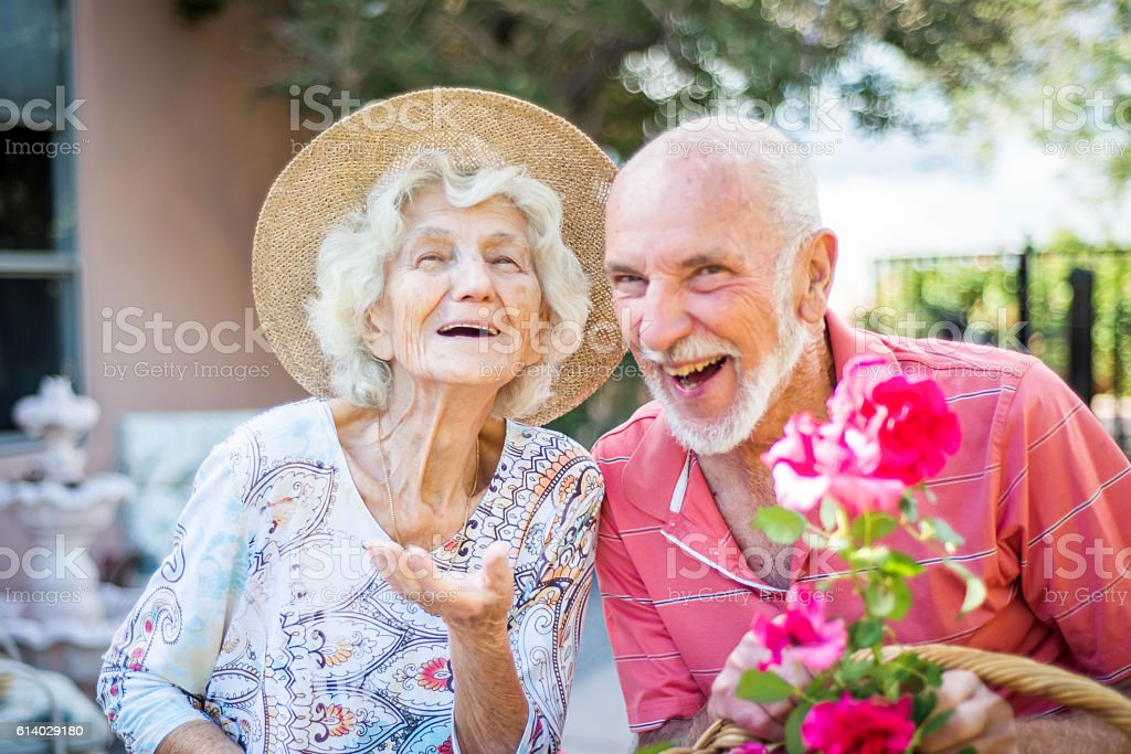 Happy senior people in the garden stock photo