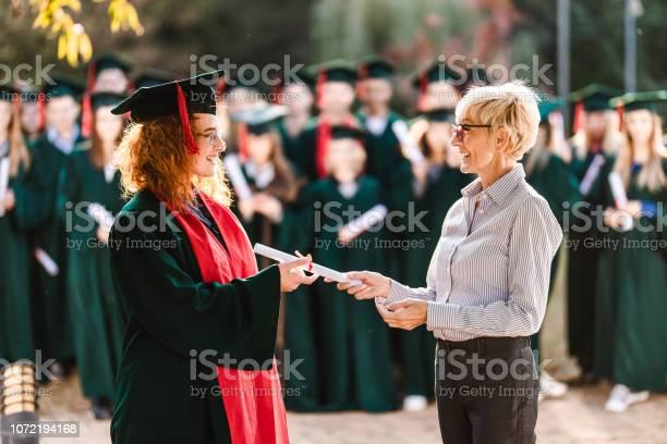 Happy senior professor giving diploma to female student on graduation picture id1072194168?b=1&k=6&m=1072194168&s=612x612&h=tdnwf6tqxphgdc5yaaufj5zt9dj0dq8dmctpalyl9yu=