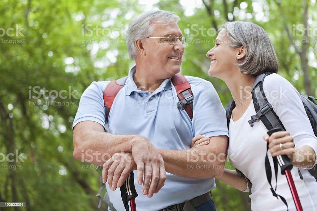 Happy senior retired couple hiking together royalty-free stock photo