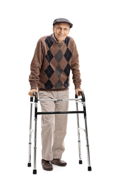 Happy senior using a walker Full length portrait of a happy senior using a walker isolated on white background one senior man only stock pictures, royalty-free photos & images
