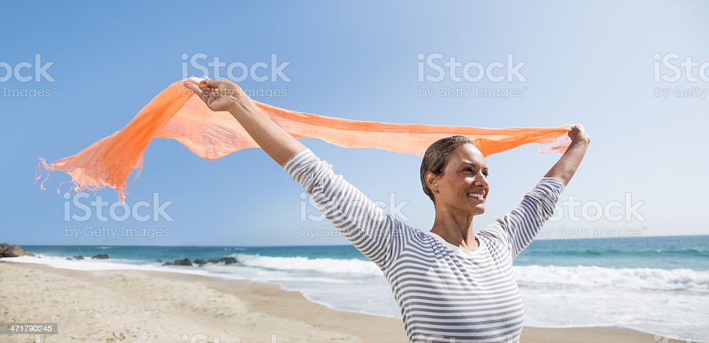 Happy senior woman enjoying the wind stock photo