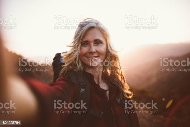 Happy senior woman hiker taking a selfie on mountain edge picture id804228794?b=1&k=6&m=804228794&s=612x612&h=lp7bqb  6eoq49t2n8pymn3hbjmecphm9 u3 25nigu=