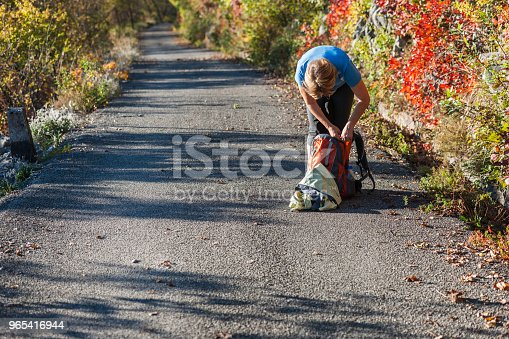 Happy Senior Woman Hiking At Autumnal Dawn In Julian Alpsitaly Europe Stock Photo & More Pictures of 55-59 Years