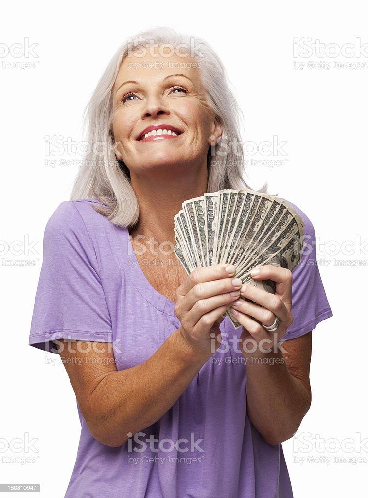 Happy Senior Woman Holding Banknotes - Isolated royalty-free stock photo