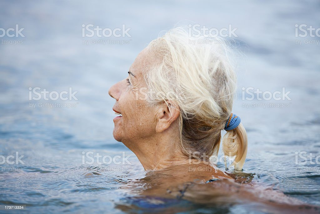 Happy Senior Woman In The Sea royalty-free stock photo