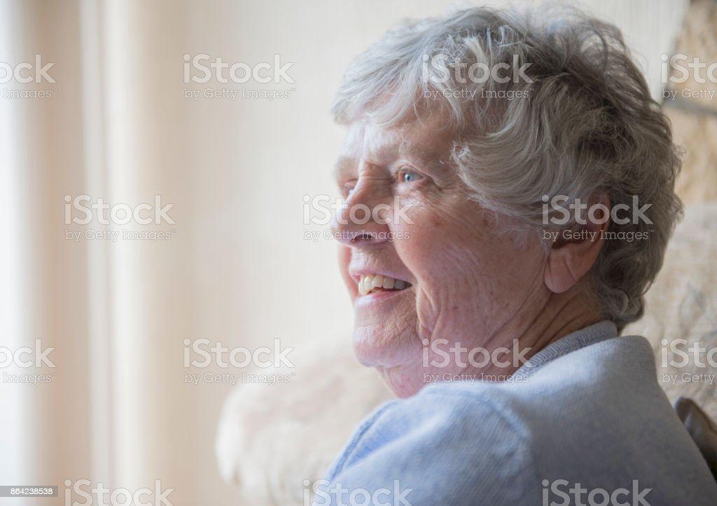 Happy senior woman indoors smiling royalty-free stock photo