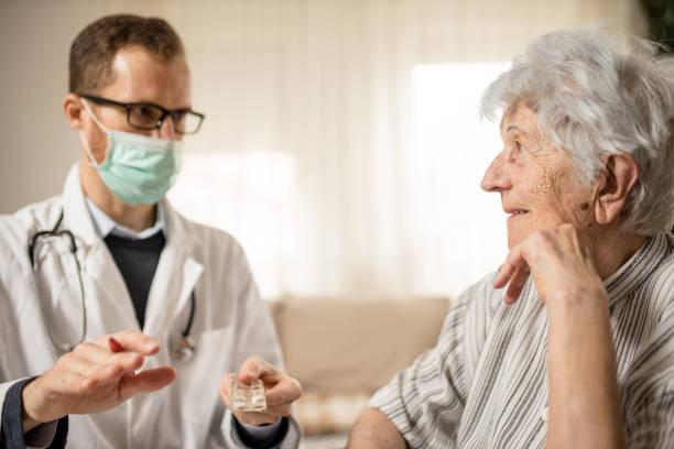 Happy senior woman listening as her doctor is explaining therapy picture id1211349854?b=1&k=6&m=1211349854&s=612x612&w=0&h=vdh6wub6bfg3kyfuh kll 01yemlnj9g3mbwzqkd8m8=