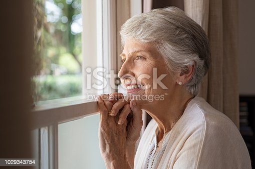 istock Happy senior woman looking away 1029343754