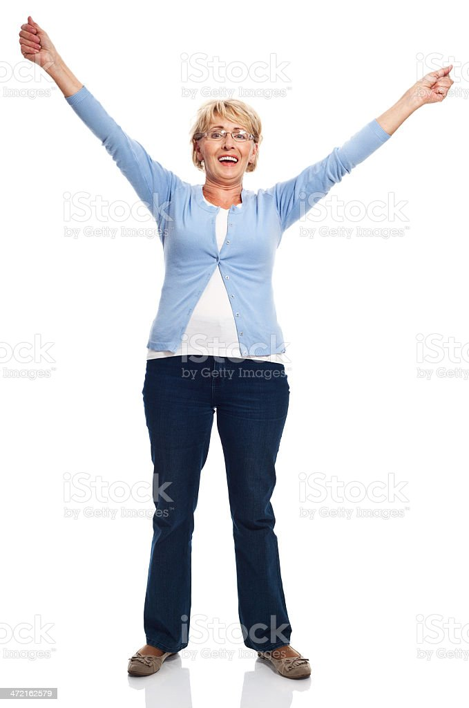 Happy senior woman Full lenght portrait of happy senior woman standing with raised hands. Studio shot, white background. 60-69 Years Stock Photo