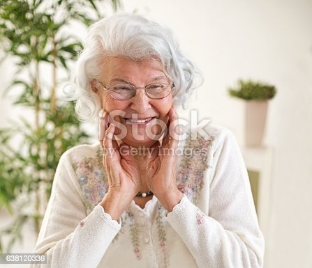 istock Happy senior woman portrait 638120336