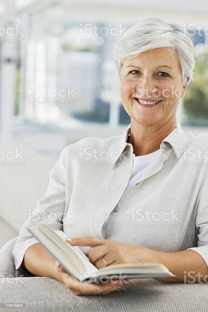 Happy senior woman reading a book royalty-free stock photo