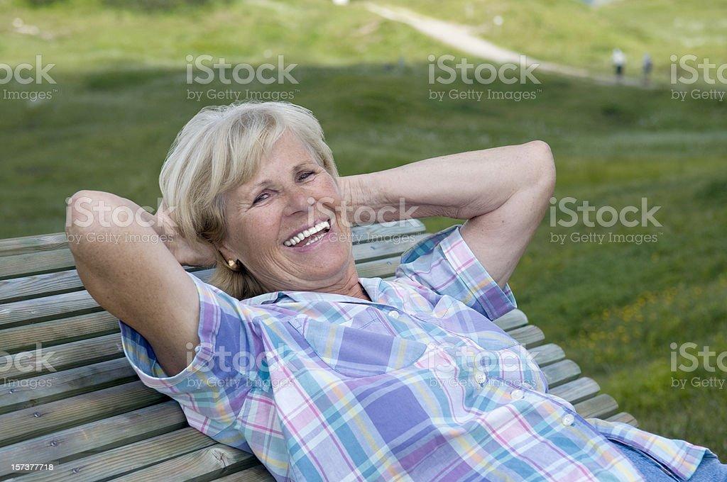 happy senior woman relaxing royalty-free stock photo