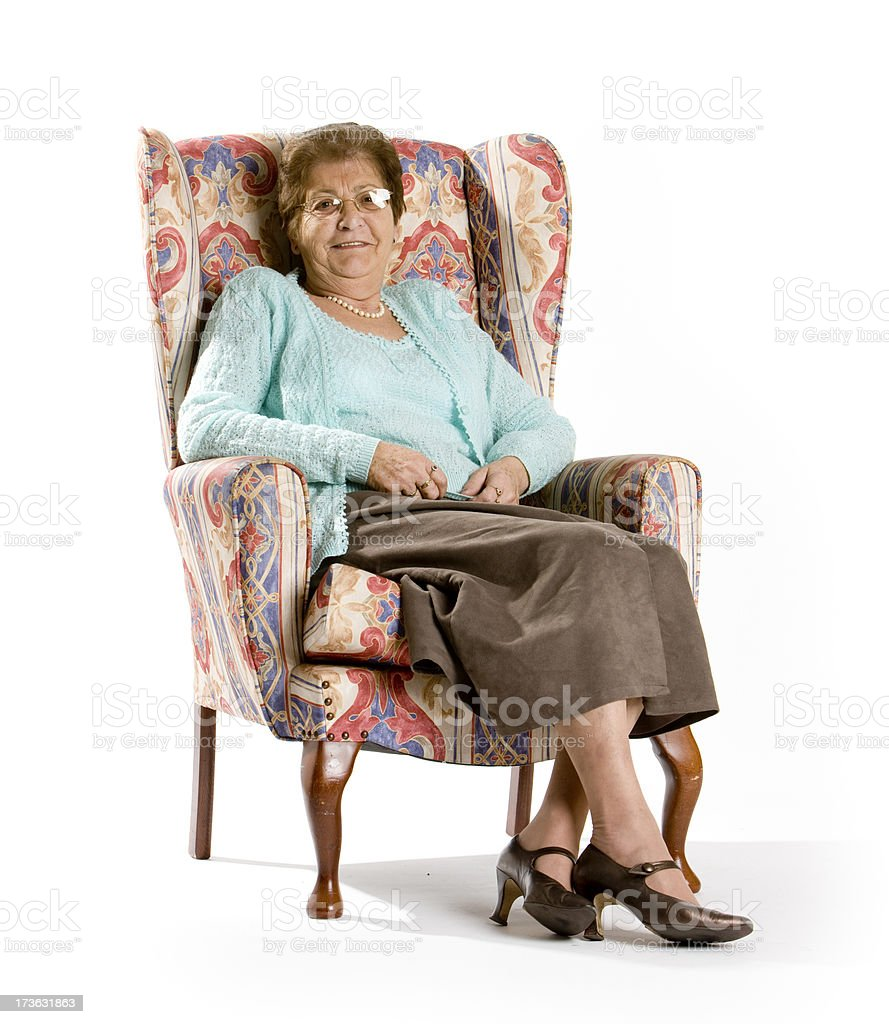 Happy Senior woman sitting in a chair royalty-free stock photo