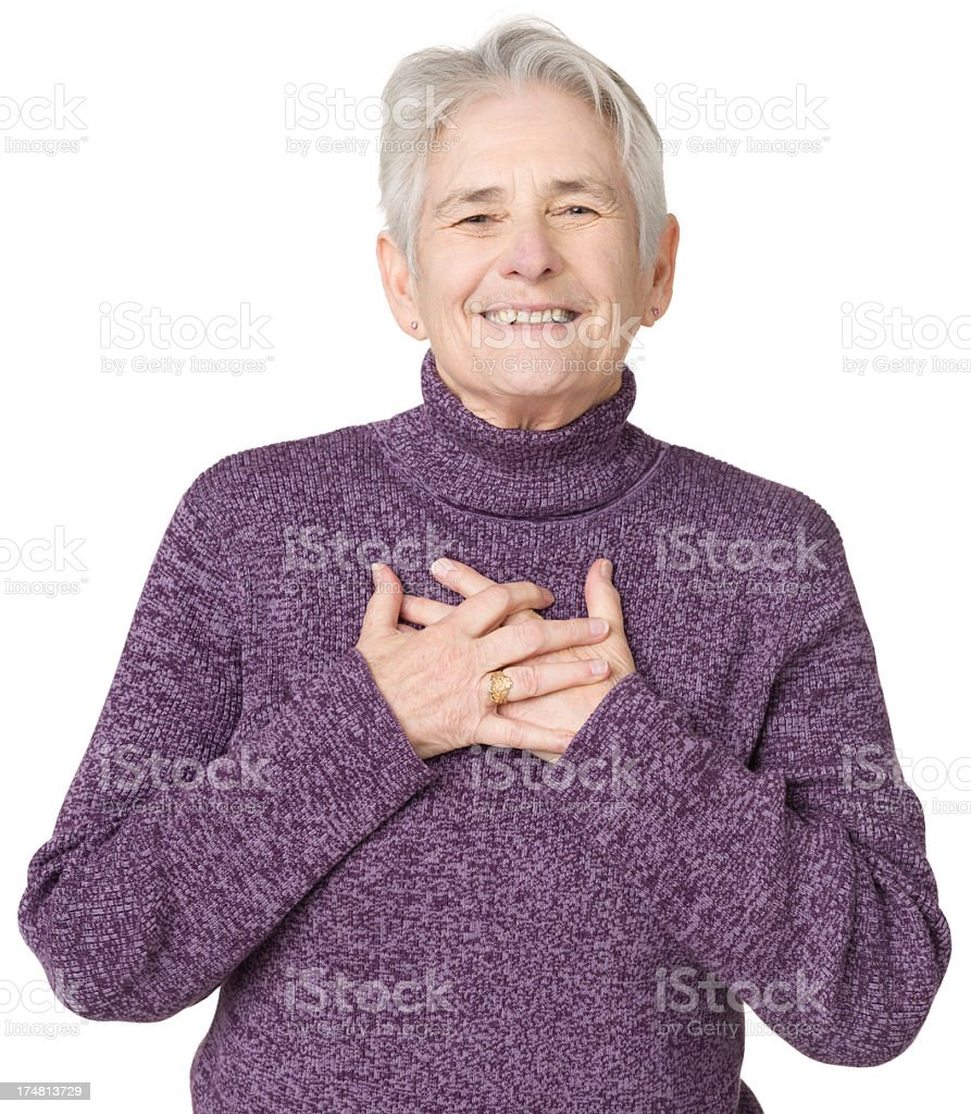 Happy Senior Woman With Hands On Chest stock photo