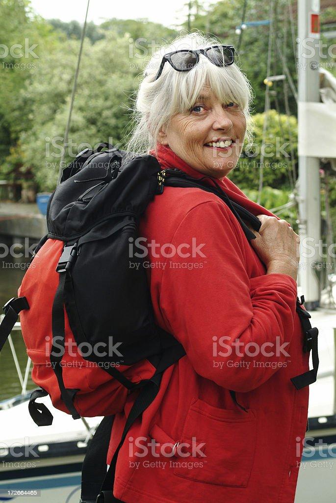 Happy senior woman with Rucksack royalty-free stock photo