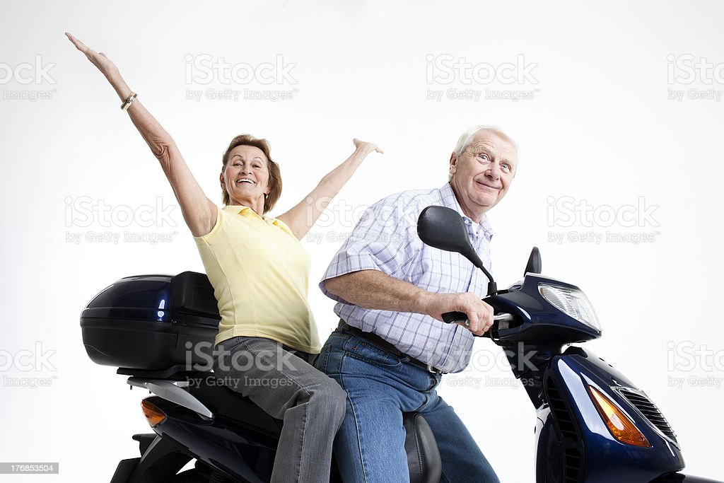 happy seniors at the motor scooter royalty-free stock photo