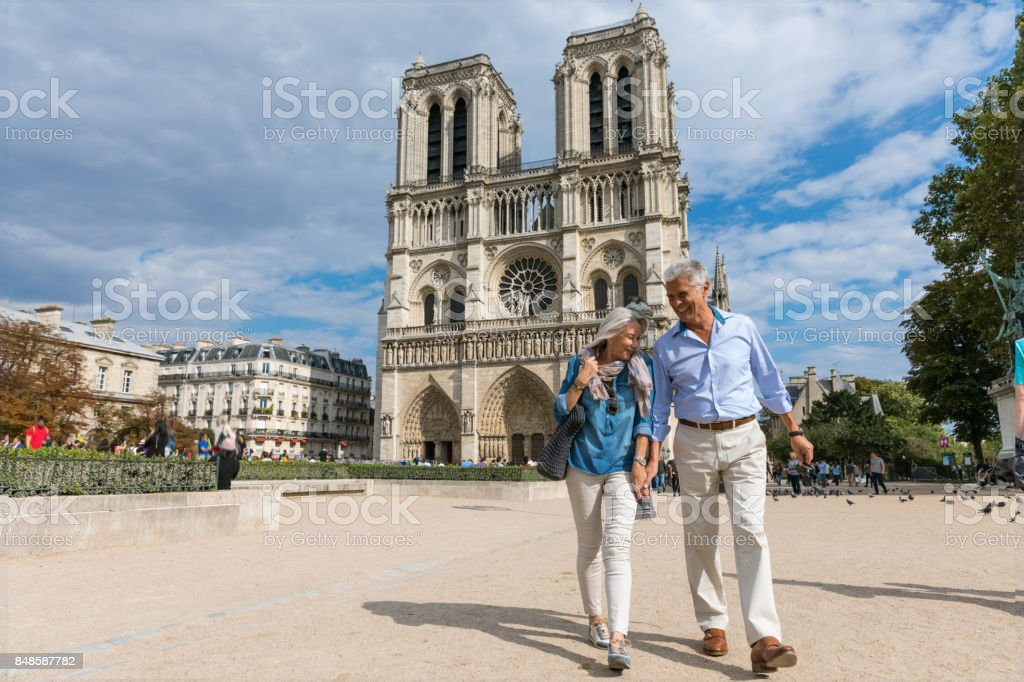 Happy seniors in Paris, having a wonderful vacation