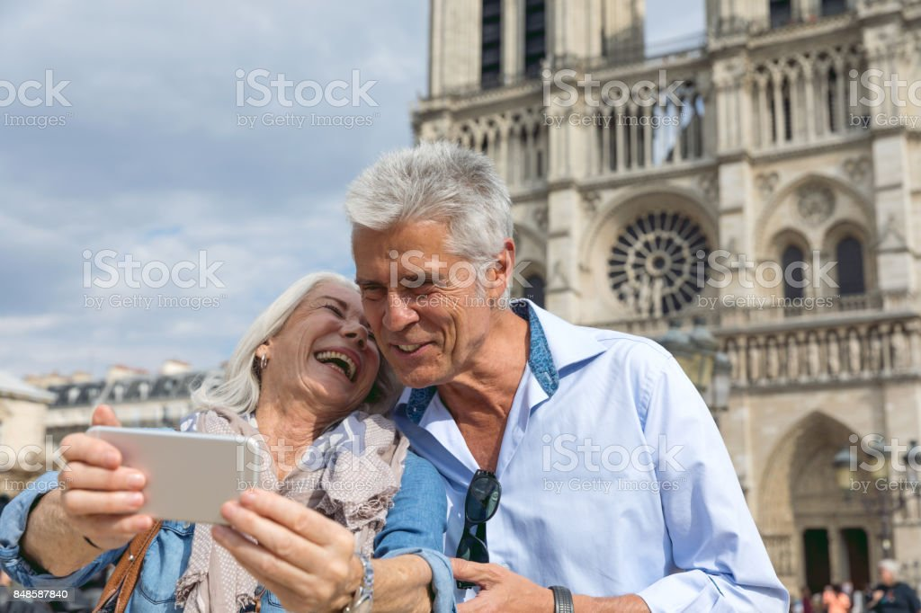 Happy seniors in Paris, having a wonderful vacation stock photo